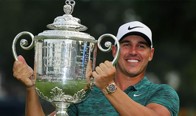 Brooks Koepka wins the 100th PGA Championship and hoists the Wannamaker Trophy