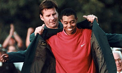 Tiger Woods receives the Green Jacket from Nick Faldo