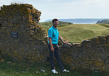 MediaDrive Captain, Simon B, contemplating my shot through the Old Church wall on the 7th hole - Pennard - Photo by reviewer